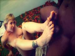 Super hot blonde sucks cock then jerks it off with her feet!