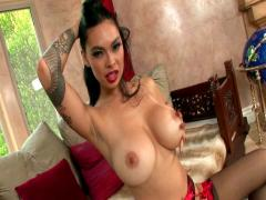 Tera Patrick is stripping for you and masturbating here